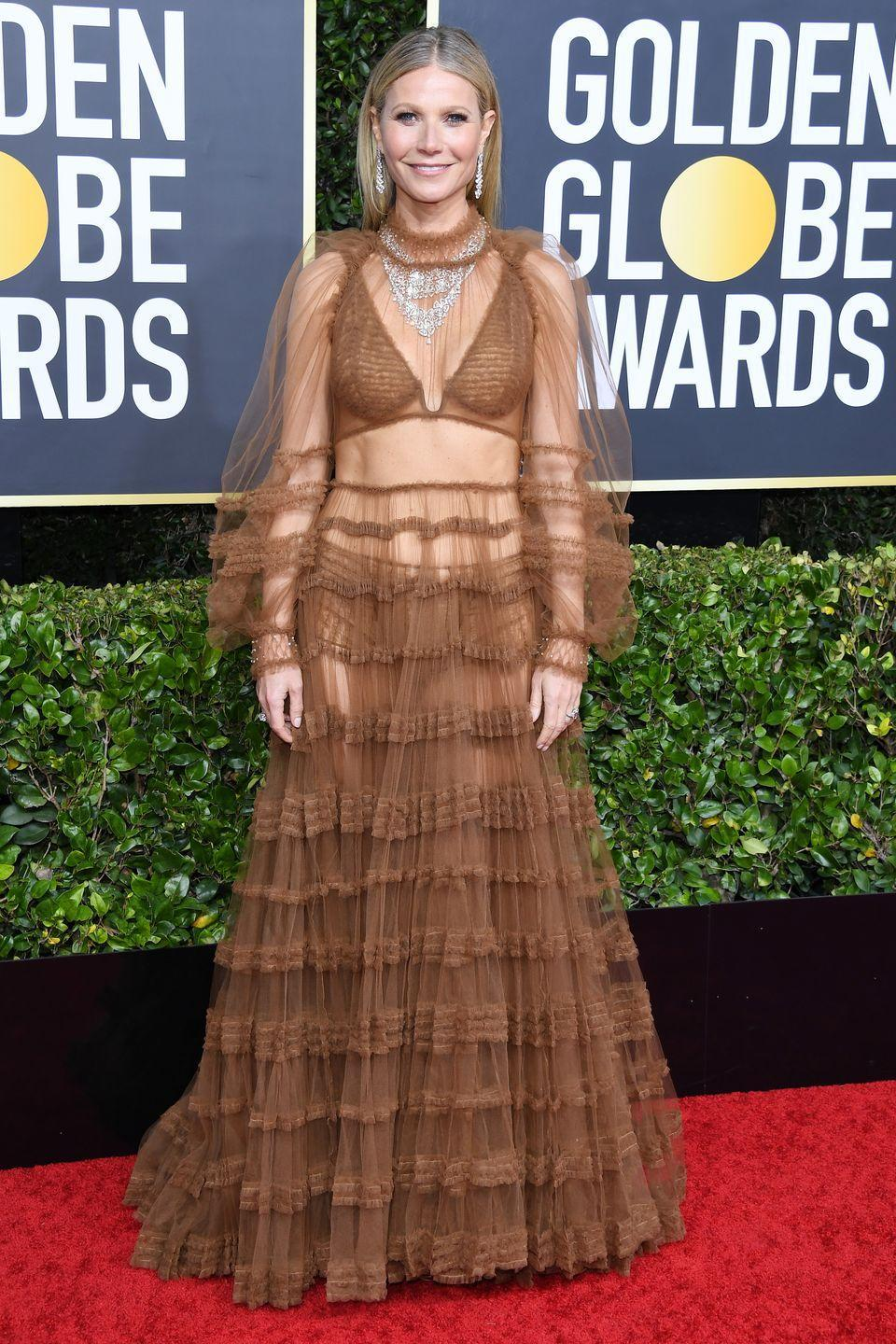 <p>In a sheer, caramel-colored Fendi tulle gown done up in delicate ruches and offset in a truly blingy Bulgari necklace—100 carats of diamonds to be exact—Paltrow shone like the star she is.</p>
