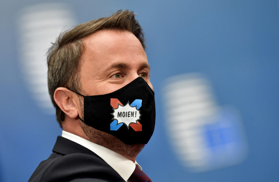 Luxembourg's Prime Minister Xavier Bettel arrives for an EU summit at the European Council building in Brussels, Friday, July 17, 2020. Leaders from 27 European Union nations meet face-to-face on Friday for the first time since February, despite the dangers of the coronavirus pandemic, to assess an overall budget and recovery package spread over seven years estimated at some 1.75 trillion to 1.85 trillion euros. (John Thys, Pool Photo via AP)