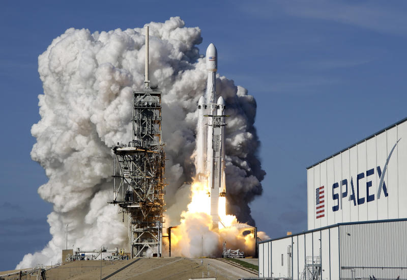 FILE - In this Tuesday, Feb. 6, 2018 file photo, a Falcon 9 SpaceX heavy rocket lifts off from pad 39A at the Kennedy Space Center in Cape Canaveral, Fla. The Falcon Heavy, has three first-stage boosters, strapped together with 27 engines in all. (AP Photo/John Raoux)