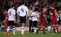 <p>Soccer Football – Champions League Semi Final Second Leg – AS Roma v Liverpool – Stadio Olimpico, Rome, Italy – May 2, 2018 Liverpool manager Juergen Klopp celebrates after the match with Mohamed Salah as Roma's Radja Nainggolan and Edin Dzeko look dejected REUTERS/Alberto Lingria </p>