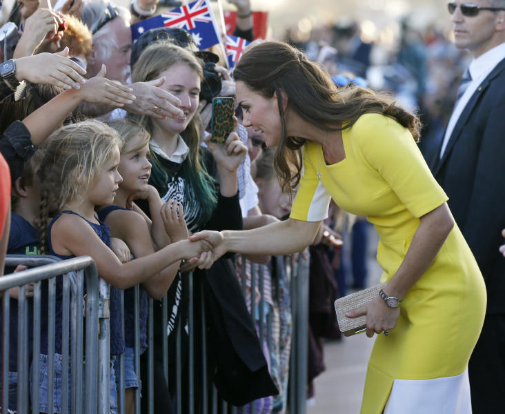 FILE - This is a Wednesday, April 16, 2014 file photo of Britain's Kate, the Duchess of Cambridge, as she meets with people on the steps of the Sydney Opera House following a reception in Sydney, Australia. Kate's dilemma: What to pack for a two-week trip, when your itinerary includes everything from state receptions and church services to toddler playdates and cricket games? For the Duchess of Cambridge, who's rounding up her trip to Australia and New Zealand with husband Prince William and 8-month-old son George, there were additional sartorial dilemmas: Do royals take off their shoes at the beach? And what's the most ladylike way to climb into a fighter jet while in a pencil dress and high heels? (AP Photo/Jason Reed, Pool, File)