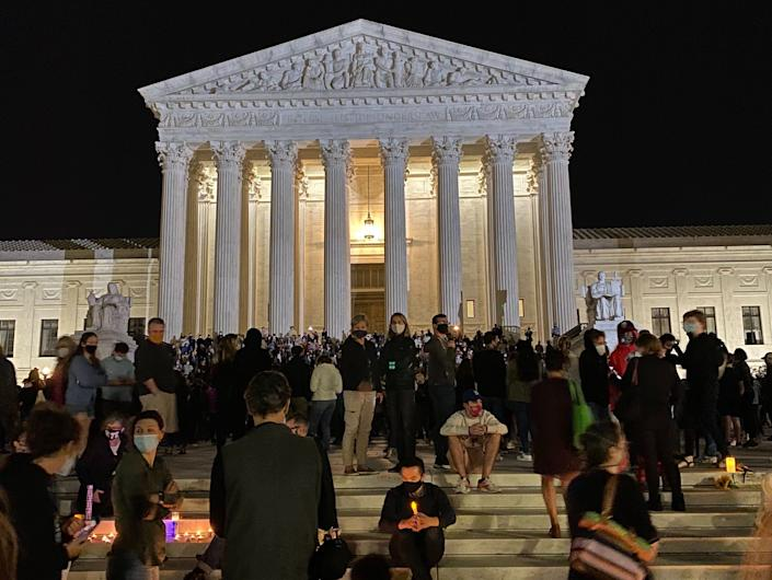 """People lit candles on the steps of the Supreme Court building to honor the late Justice Ruth Bader Ginsburg. <p class=""""copyright"""">Eliza Relman/Business Insider</p>"""