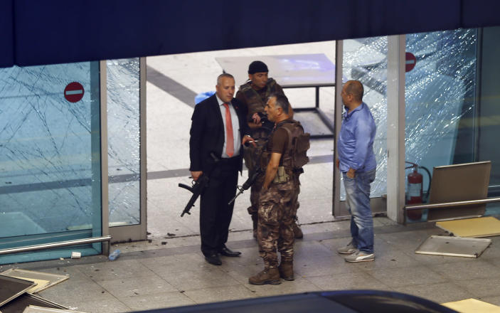 <p>Armed security stand at an entrance of Turkey's largest airport, Istanbul Ataturk, Turkey, following a blast June 28, 2016. (REUTERS/Osman Orsal) </p>
