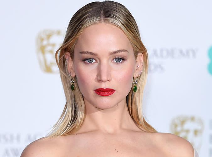 <p>Here's J.Law looking absolutely regal with her red lip and center-parted strands at this year's BAFTA awards.</p>