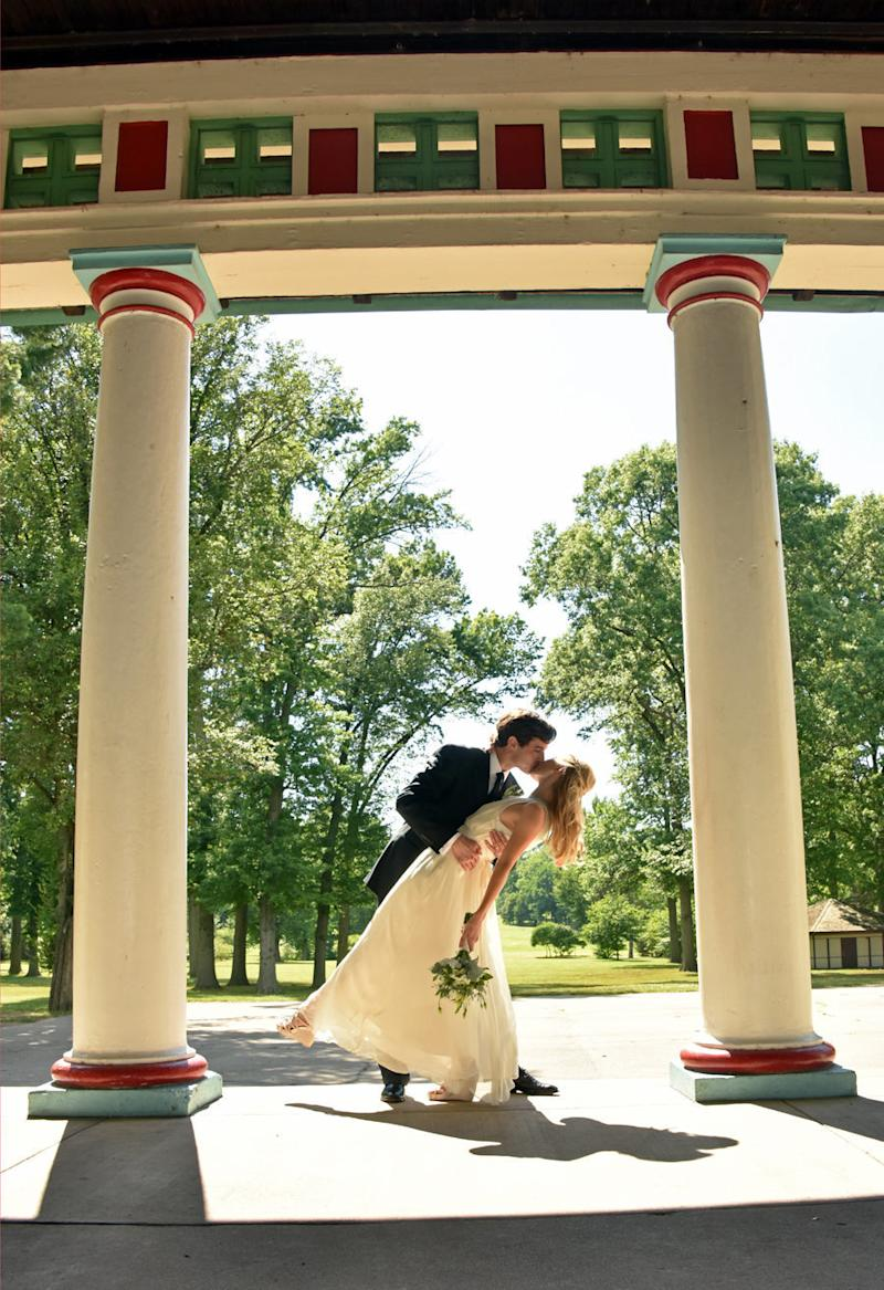 A romantic kiss at the pavilion in Tower Grove Park.  (Lawing Photography)