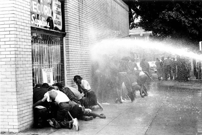Police turned water cannons and dogs against Black children in Birmingham, Alabama protesting against segregation. The 1963 march was organized by Reverend Dr. Martin Luther King Jr. (Michael Ochs/Getty Images)