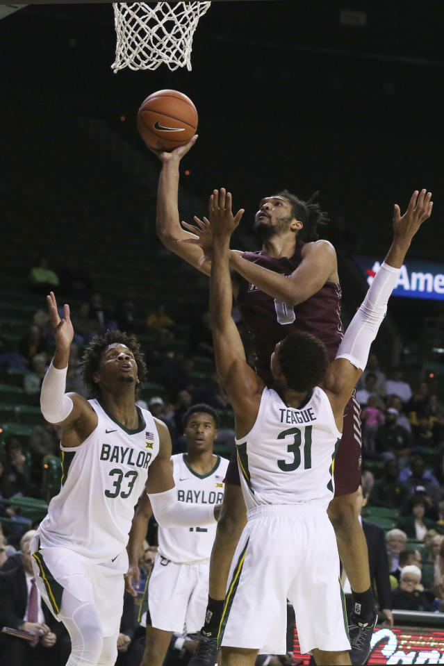 Maryland-Eastern Shore forward AJ Cheeseman, center, attempts a shot over Baylor guard MaCio Teague, right, and forward Freddie Gillespie, left, in the first half of an NCAA college basketball game, Tuesday, Dec. 3, 2019, in Waco, Texas. (AP Photo/Rod Aydelotte)