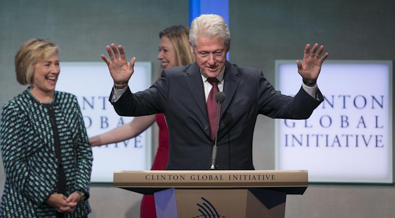 Former U.S. Secretary of State and former first lady Hillary Clinton (L) and daughter Chelsea Clinton share a laugh while former U.S. President Bill Clinton speaks at the Clinton Global Initiative 2013 (CGI) in New York September 24, 2013. REUTERS/Lucas Jackson (UNITED STATES - Tags: POLITICS)