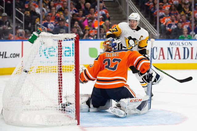 Edmonton Oilers' goaltender Cam Talbot (33) reacts as Pittsburgh Penguins' Sidney Crosby (87) scores during the first period of an NHL hockey game, Tuesday, Oct. 23, 2018 in Edmonton, Alberta. (Codie McLachlan/The Canadian Press via AP)