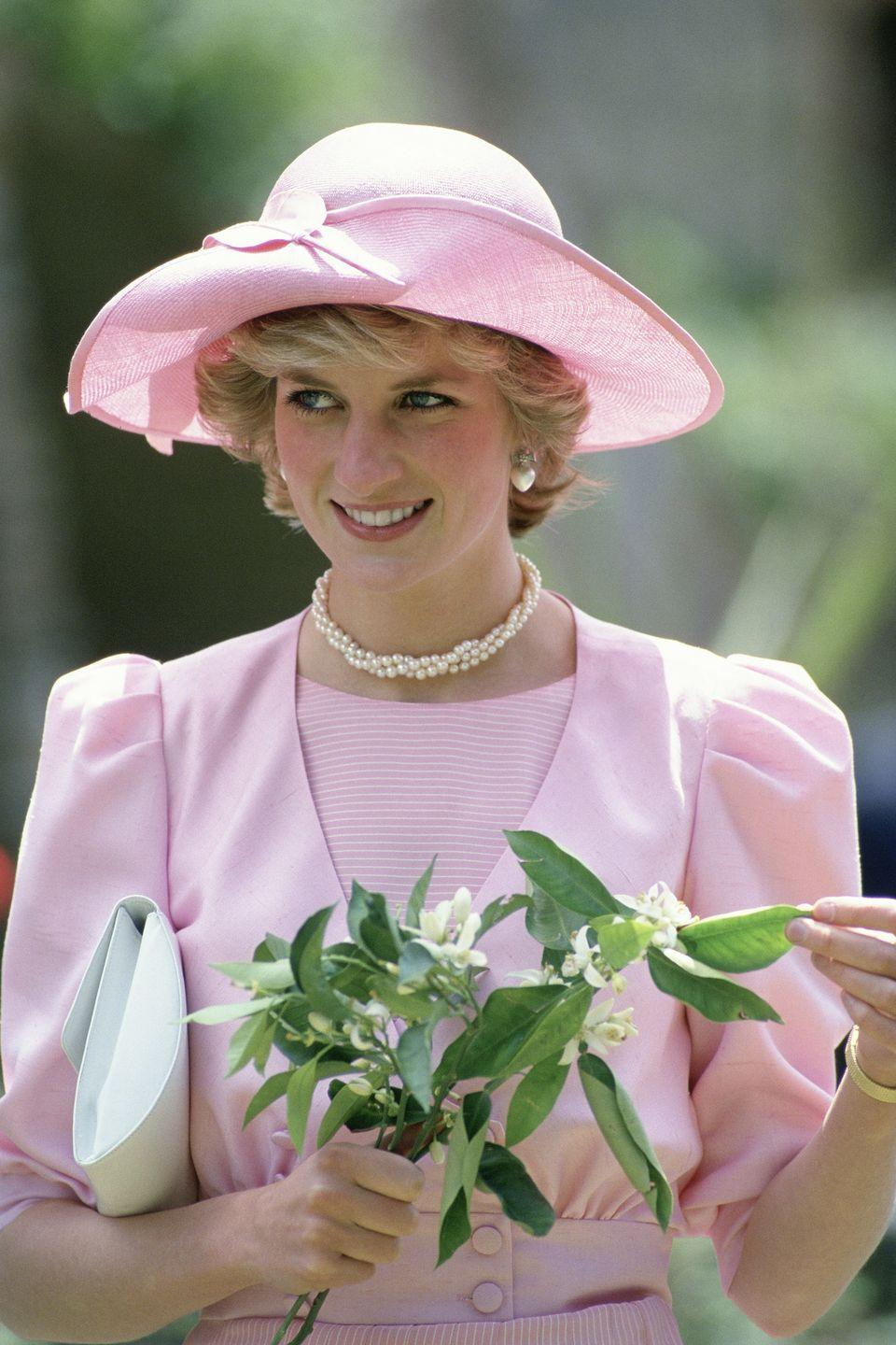 <p>In a blush John Boyd hat while touring gardens in Sicily. </p>
