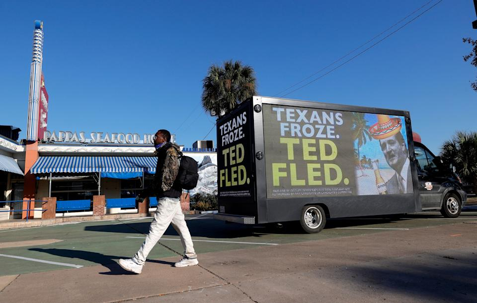 A digital billboard truck in Houston calls out Sen. Ted Cruz (R-Texas) for going to Mexico as a deadly winter storm struck his state. (Photo: Justin Sullivan/Getty Images)