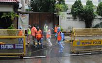 Municipal workers spray disinfectant outside the gate of Bollywood actor Amitabh Bachchan's bungalow. Bollywood actor Amitabh Bachchan tested positive for coronavirus and has been admitted to a hospital where he is being kept in quarantine. The actor requested those who had come in close proximity in the past ten days to get themselves tested for the virus. (Photo by Ashish Vaishnav/SOPA Images/LightRocket via Getty Images)
