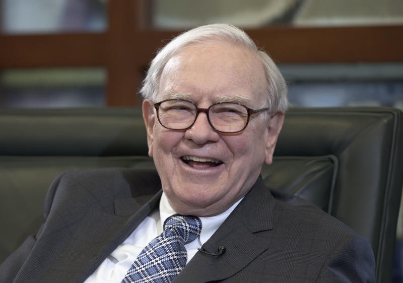 Warren Buffett, chairman and CEO of Berkshire Hathaway, laughs during an interview with Liz Claman of the Fox Business Network in Omaha, Neb., Monday, May 7, 2012. Buffett said on Monday that Europe will have a hard time resolving its fiscal problems because of the structure of the European Union and this weekend's election results in Greece and France, but he says the turmoil in Europe won't keep him from investing. Buffett said Berkshire plans to buy two U.S. stocks Monday that it already holds to add to its stakes in those companies. (AP Photo/Nati Harnik)