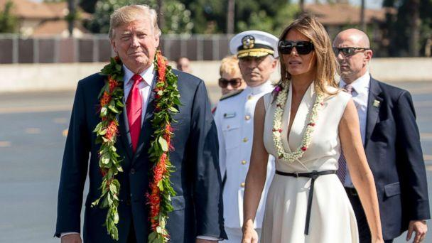PHOTO: President Donald Trump and first lady Melania Trump wear leis as they arrive at Joint Base Pearl Harbor Hickam, Hawaii, Nov. 3, 2017. (Andrew Harnik/AP)