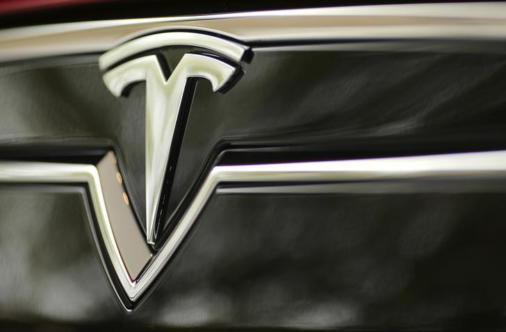 A Tesla Motors logo is shown on a Tesla Model S at a Tesla Motors dealership at Corte Madera Village, an outdoor retail mall, in Corte Madera
