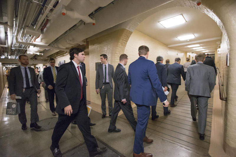 Members of Congress and their aides walk through a basement tunnel on Capitol Hill in 2015.