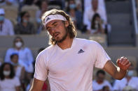 Stefanos Tsitsipas of Greece reacts as he plays Serbia's Novak Djokovic during their final match of the French Open tennis tournament at the Roland Garros stadium Sunday, June 13, 2021 in Paris. (AP Photo/Michel Euler)