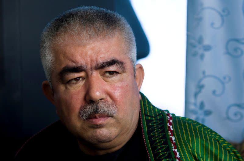 FILE PHOTO: Afghan General Dostum speaks during an interview with Reuters at his Palace in Shibergan