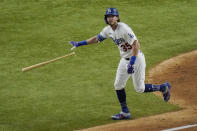Los Angeles Dodgers' Cody Bellinger watches his two-run home run against the Tampa Bay Rays during the fourth inning in Game 1 of the baseball World Series Tuesday, Oct. 20, 2020, in Arlington, Texas. (AP Photo/Sue Ogrocki)