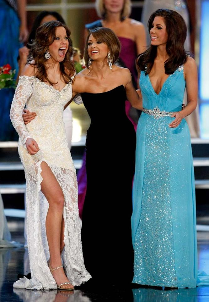 """Katie R. Stam (L), Miss Indiana, reacts as she is named the new Miss America as finalists Jackie Geist (C), Miss California, and Ellen Carrington (R), Miss Tennessee, look on during the <a href=""""/miss-america-countdown-to-the-crown/show/44013"""">2009 Miss America Pageant</a> at the Planet Hollywood Resort & Casino January 24, 2009 in Las Vegas, Nevada."""