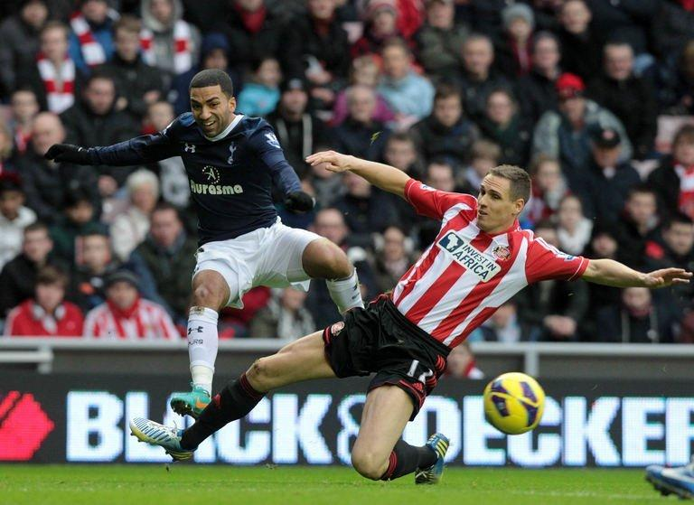 Sunderland's Matthew Kilgallon (R) tackles Tottenham's Aaron Lennon at The Stadium of Light on December 29, 2012