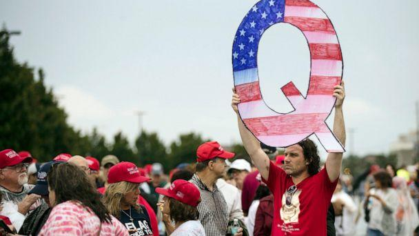 PHOTO: In this Aug. 2, 2018, file photo, a protesters holds a Q sign waits in line with others to enter a campaign rally with President Donald Trump in Wilkes-Barre, Pa. (Matt Rourke/AP, File)
