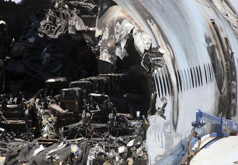 Burned seats are visible in the wrecked fuselage of Asiana Airlines Flight 214 in a storage area at San Francisco International Airport on July 12, 2013 in California (AFP Photo/Justin Sullivan)