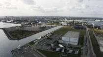 Image taken from video showing an aerial view of the UNICEF warehouse, the world's largest humanitarian aid warehouse, in Copenhagen, Denmark, Tuesday Oct. 13, 2020. For Burkina Faso, India, Venezuela and other countries with shaky health care delivery systems, the best chance for receiving scarce supplies of a coronavirus vaccine is through the Covax initiative, led by the World Health Organization and the Gavi vaccine alliance. UNICEF began laying the groundwork months ago in Copenhagen, at the world's largest humanitarian aid warehouse. (AP Photo)