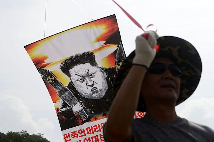A North Korean defector prepares to release balloons carrying propaganda leaflets denouncing recent North Korea nuclear tests near the Demilitarized Zone, on September 15, 2016.