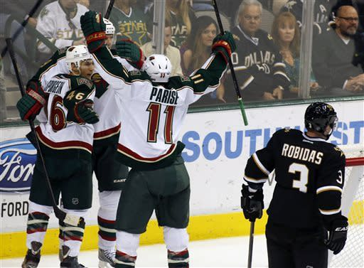Minnesota Wild defenseman, Jared Spurgeon (46), forward, Mikko Koivu (9), and forward, Zach Parise (11) celebrate Spurgeon's goal as Dallas Stars defenseman Stephane Robidas (3) skates away during the second period of an NHL hockey game Friday, March 29, 2013, in Dallas, Texas. (AP Photo/Sharon Ellman)