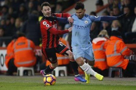 Britain Football Soccer - AFC Bournemouth v Manchester City - Premier League - Vitality Stadium - 13/2/17 Manchester City's Sergio Aguero in action with Bournemouth's Adam Smith  Action Images via Reuters / Matthew Childs Livepic