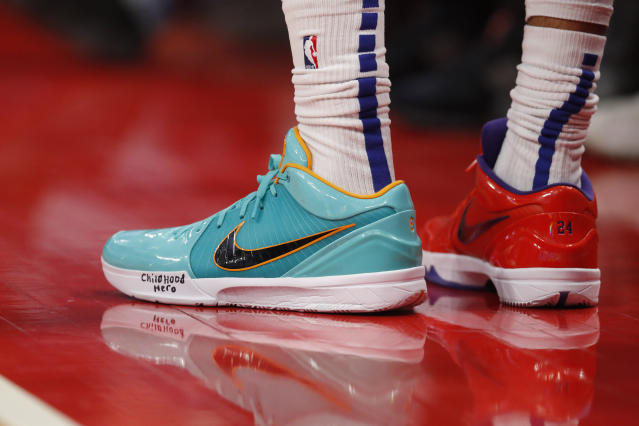 Close up of Detroit Pistons forward Christian Woods shoes as he honors Kobe Bryant during the first half of an NBA basketball game against the Cleveland Cavaliers, Monday, Jan. 27, 2020, in Detroit. (AP Photo/Carlos Osorio)