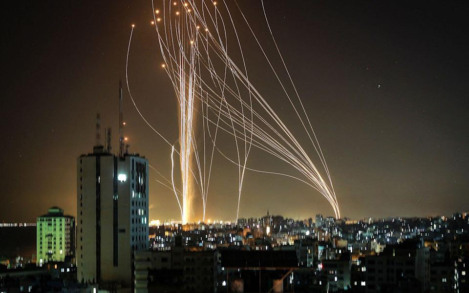 Streaks of light are seen as Israel's Iron Dome anti-missile system intercept rockets launched from the Gaza Strip towards Israel, as seen from Ashkelon - ANAS BABA Source: AFP/ANAS BABA Source: AFP