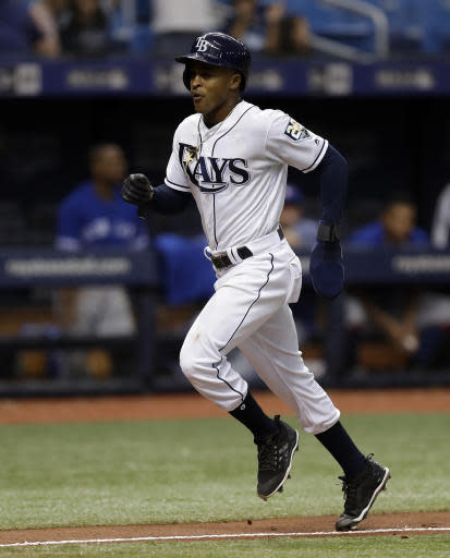 Tampa Bay Rays' Mallex Smith scores the game-winning run on an RBI single by Matt Duffy off Toronto Blue Jays relief pitcher Ryan Tepera during the ninth inning of a baseball game Wednesday, June 13, 2018, in St. Petersburg, Fla. The Rays won the game 1-0. (AP Photo/Chris O'Meara)