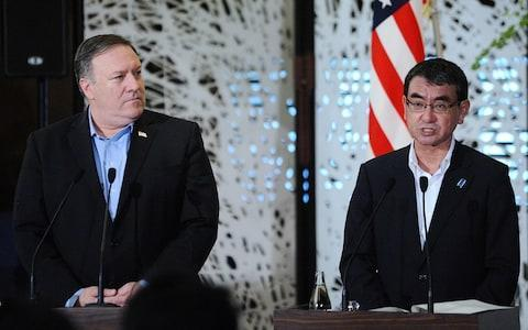 <span>Taro Kono, Japan's foreign minister, right, speaks during a news conference with Mike Pompeo, U.S. secretary of state</span> <span>Credit: Bloomberg </span>