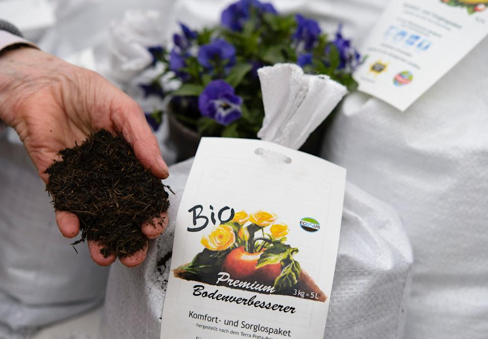 File  A sales assistant shows organic flower soil at the biannual gardeners' market at the Botanical Gardens on April 5, 2014 in Berlin (Getty Images)