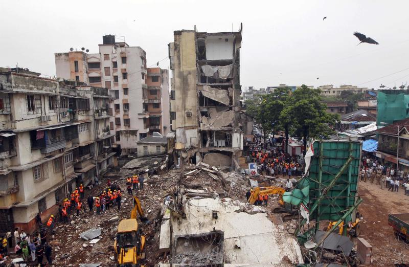 5 die, 5 feared trapped in India building collapse