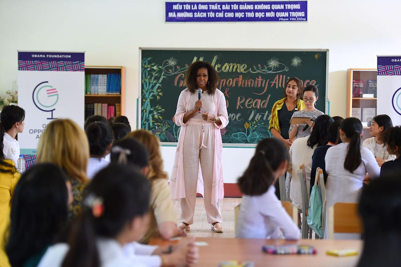 <p>Speaking to Vietnamese students in the Can Giuoc district to promote girls' education in the region, Michelle Obama wears a pastel-pink linen suit, paired with shimmering espadrilles.</p>