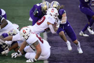 Stanford running back Austin Jones dives into the end zone on a touchdown run against Washington in the first half of an NCAA college football game Saturday, Dec. 5, 2020, in Seattle. (AP Photo/Elaine Thompson)