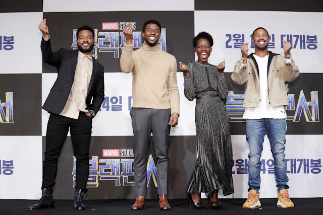"From left, ""Black Panther"" director Ryan Coogler flashes a finger heart alongside actors Chadwick Boseman, Lupita Nyong'o and Michael B. Jordan at the Seoul premiere of their movie earlier this month."