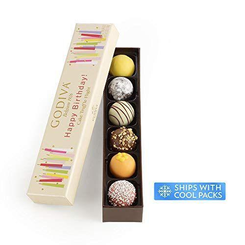 """<p><strong>GODIVA Chocolatier</strong></p><p>amazon.com</p><p><strong>$19.00</strong></p><p><a href=""""https://www.amazon.com/dp/B00UAJ7XIS?tag=syn-yahoo-20&ascsubtag=%5Bartid%7C10050.g.31701949%5Bsrc%7Cyahoo-us"""" rel=""""nofollow noopener"""" target=""""_blank"""" data-ylk=""""slk:Shop Now"""" class=""""link rapid-noclick-resp"""">Shop Now</a></p><p>This festive box is decorated with colorful birthday candles—and the chocolates within it are downright beautiful. It's an oh-so-relevant gift for any chocolate lover's birthday.</p>"""