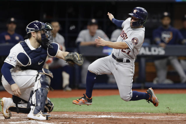 Houston Astros' Jose Altuve, right, heads for home, but is tagged out by Tampa Bay Rays catcher Travis d'Arnaud during the fourth inning of Game 4 of a baseball American League Division Series, Tuesday, Oct. 8, 2019, in St. Petersburg, Fla. (AP Photo/Chris O'Meara)