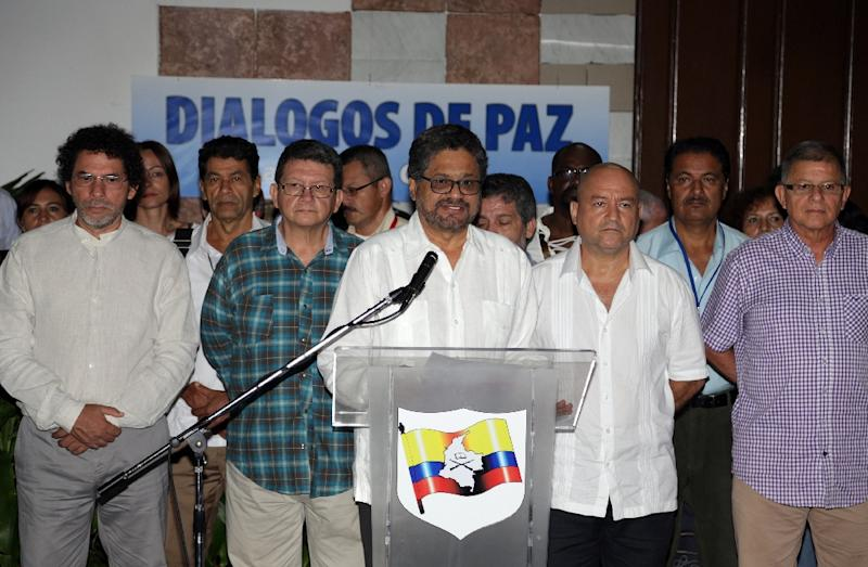 In Cuba earlier in July, the FARC guerrilla delegation headed by Ivan Marquez (C) met with the Colombian government for peace talks and agreed to begin a month-long truce (AFP Photo/HO)
