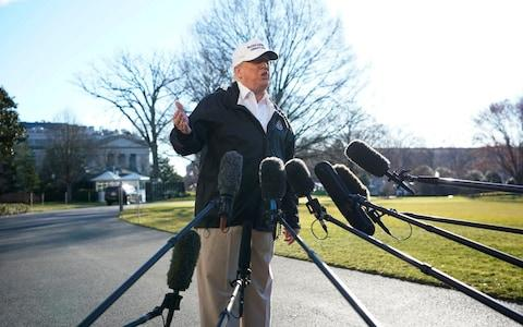 Donald Trump addresses the cameras on Thursday morning outside of the White House - Credit: REUTERS/Carlos Barria