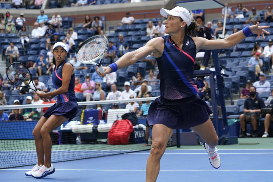 Shual Zhang, of China, left, and Samatha Stosur, of Australia, compete against Coco Gauff and Catherine McNally, both of the United States, during the women's doubles final at the US Open tennis championships, Sunday, Sept. 12, 2021, in New York. (AP Photo/Elise Amendola)
