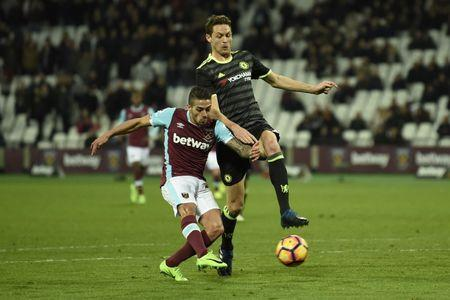 Britain Football Soccer - West Ham United v Chelsea - Premier League - London Stadium - 6/3/17 West Ham United's Manuel Lanzini scores their first goal  Action Images via Reuters / Tony O'Brien Livepic