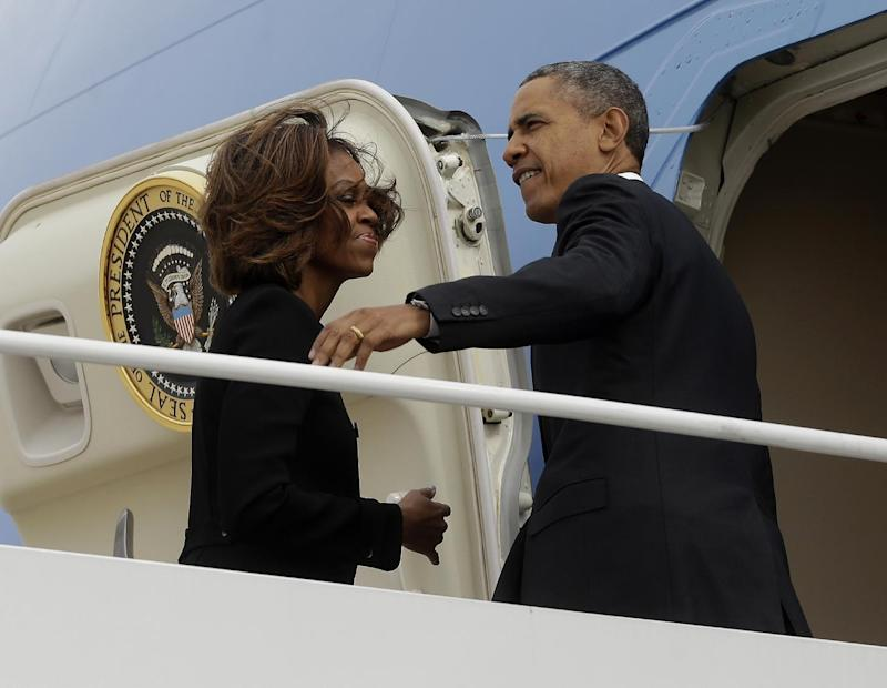 President Barack Obama and first Lady Michelle Obama prepare to board Air Force One before their departure from Andrews Air Force Base, Friday, March 7, 2014. Obama and the first lady are traveling to Miami and will visit a local high school to unveil a new initiative program to ensure more students complete the Free Application for Federal Student Aid (FAFSA), a document required by most types of financial aid such as Pell grants. (AP Photo/Pablo Martinez Monsivais)