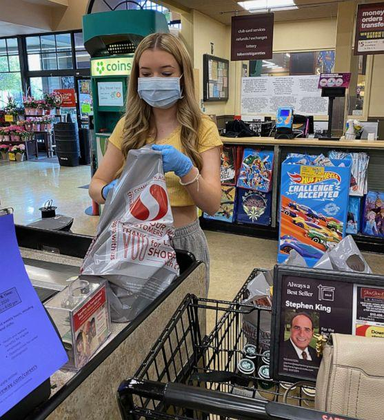 PHOTO: High-school junior Natalie Reese picks up supplies from the store for sanitation kits that she and her family give out to UPS and mail workers in Danville, Calif. (Courtesy Laurie Reese)
