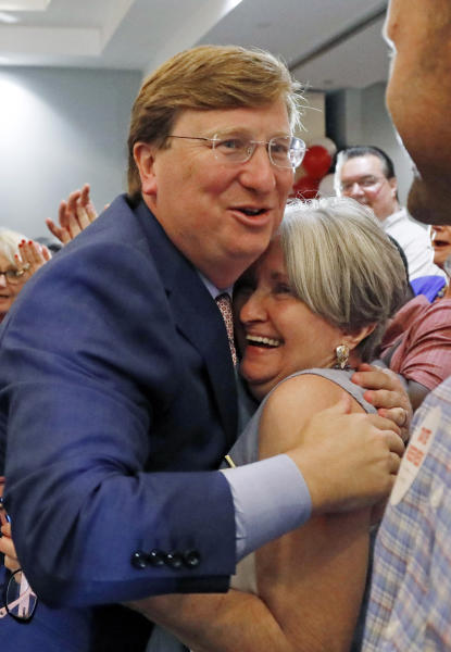Republican Lt. Gov. Tate Reeves, a gubernatorial candidate, left, is congratulated by a supporter at his election watch party in Flowood, Miss., Tuesday, Aug. 6, 2019. Reeves was in the lead of his party primary. (AP Photo/Rogelio V. Solis)