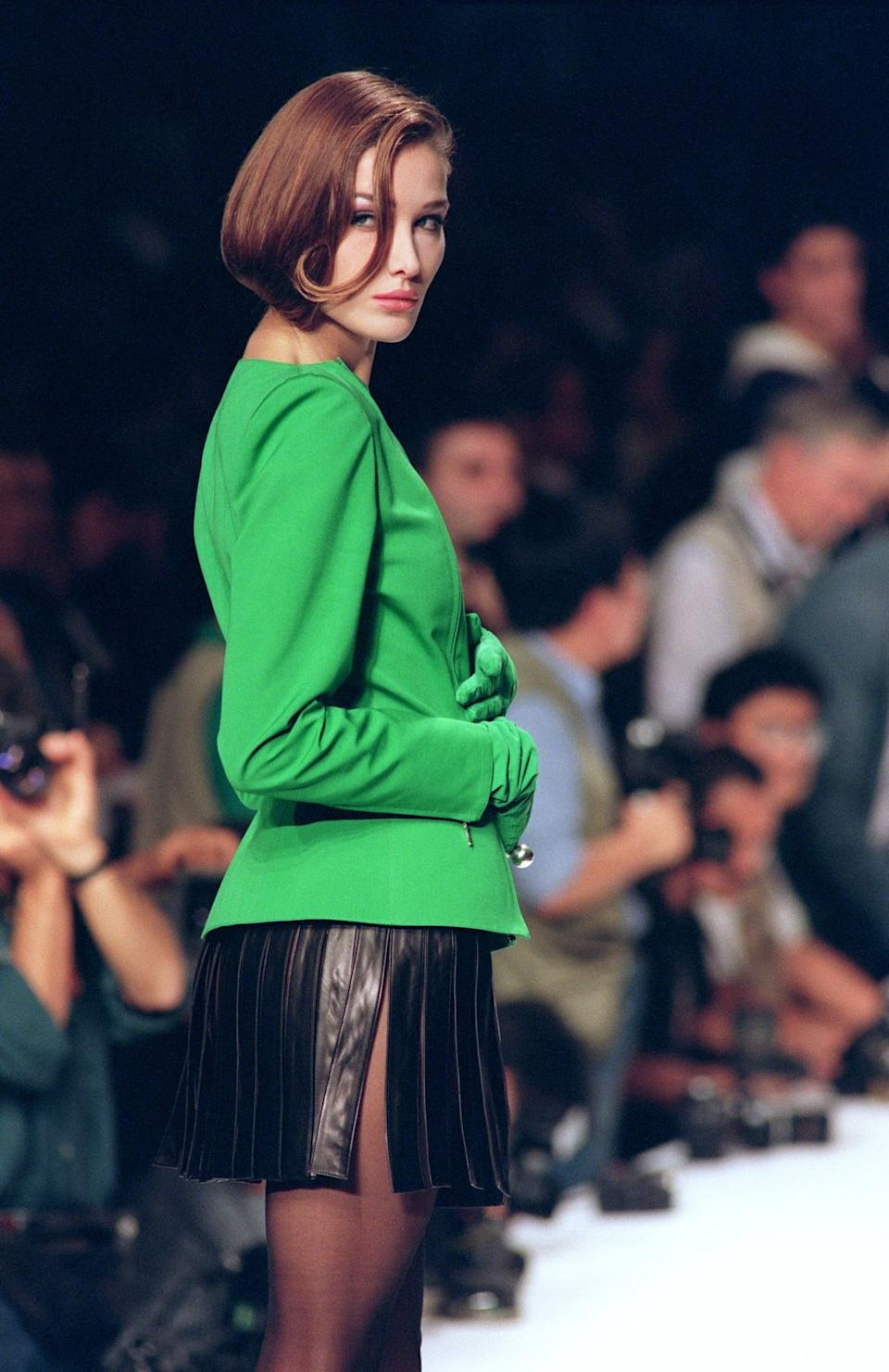"<div class=""inline-image__caption""><p>Carla Bruni Tedeschi on October 20, 1990, in Paris during Claude Montana's 1991 summer ready-to-wear show.</p></div> <div class=""inline-image__credit"">Eric Feferberg/AFP/Getty</div>"